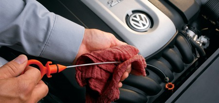 Volkswagen oil change - service tech checking the oil